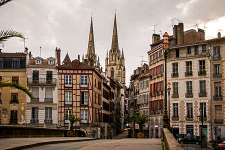 A typical street in Bayonne old tow leading to the Cathedral in winter season. Bayonne, France. Editorial