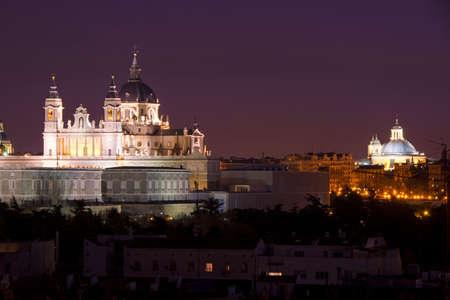 Madrid, Spain skyline at Santa Maria la Real de La Almudena Cathedral and the Royal Palace at night Editorial