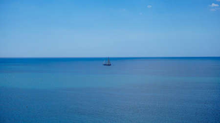 A single boat in the middle of the ocean Stock Photo - 73658501