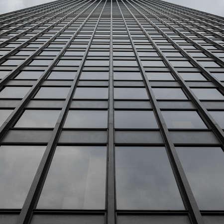 perspective grid: Grey Uniform Grid Skyscraper Stock Photo