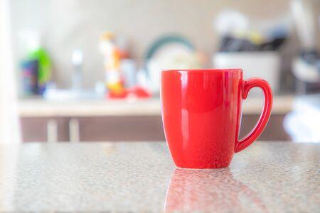 Red mug on granite table