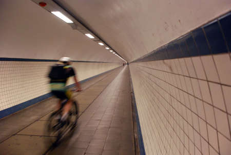 A cyclist travelling with high speed through a tunnel in the city of Antwerp (Belgium) Stock Photo - 950954