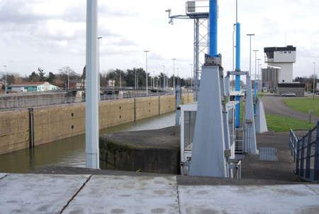 lowering: Lock on the Albert canal located in Wijnegem, near Antwerp
