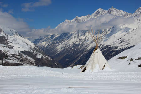 swiss alps: Indian style teepee tent set high up in the Swiss Alps