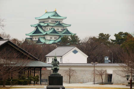 Nagoya Castle in the background with a statue of the master Japanese castle architect Kato Kiyomasa