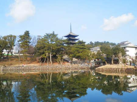 storied: Sarusawa Pond with the five-storied pagoda of the Kofuku-ji Temple in Nara, Japan