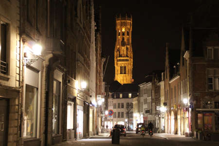 Cobble stone street of Bruges at night.
