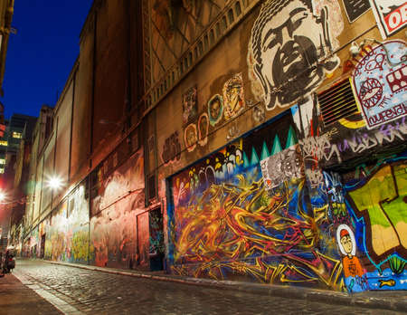 A city alley in Melbourne with prominent street art Editorial