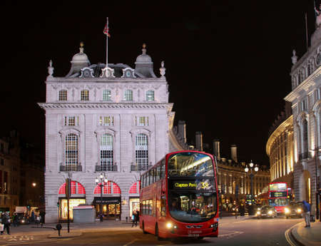 west end: Double decker driving through Londons West End, Piccadilly Circus. Editorial