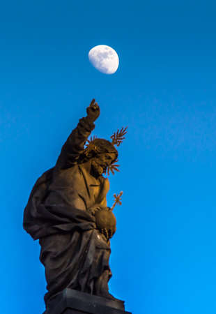 Christ the teacher pointing up to the moon above. Stock Photo