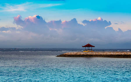 Balinese gazebo out on the open water during sunset