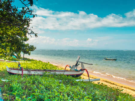Traditional fishing boat on the beach in Sanur Bali Indonesia Stock Photo