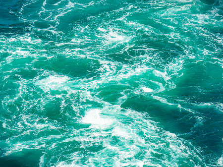 Lots forming  whirlpools in the ocean at the Naruto whirlpools in Tokushima Фото со стока