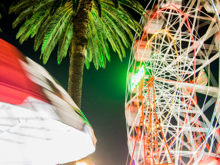 AUSTRALIA, MELBOURNE - March 07, 2015: Bright illuminated lights from festival rides