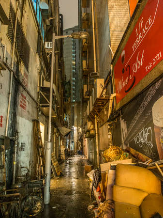 HONG KONG, KOWLOON - NOVEMBER 7, 2014: Back alley of Hong Kong at night