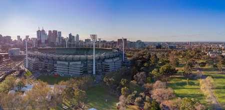 AUSTRALIA, MELBOURNE - SEPTEMBER 21, 2018: Aerial shot of the Melbourne Cricket Ground with Melbourne city skyline behind 에디토리얼