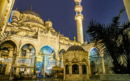 """TURKEY, ISTANBUL - MARCH 15, 2015: Night shot from the courtyard inside Yeni Cami Mosque, nicknamed """"The New Mosque"""""""