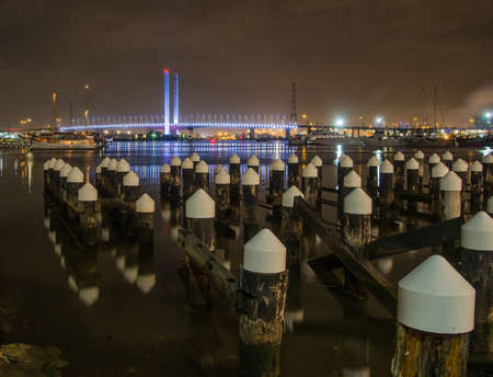 Melbourne Docklands with illuminated bridge in the background at night