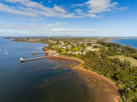 Aerial view of the Pier and Boat Ramp of the township of Corinella in Victoria's Western Port Bay, Australia