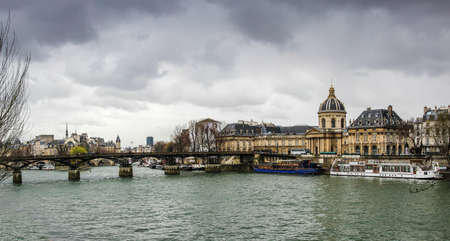 France, Paris - April 9, 2013: Pont des Arts spanning the Seine River at the front of the Mazarin Library