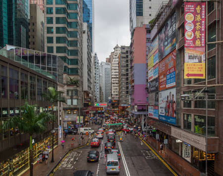 Hong Kong, Causeway Bay - November 8, 2014: Busy streets in Causeway Bay. The the area is a busy shopping district with luxury malls, department stores and boutiques