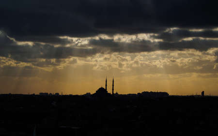 Turkey, Istanbul - March 17, 2015: Sunset over Istanbul with a silhouette of a mosque rising high above the surrounding buildings.