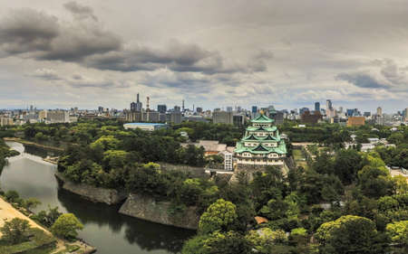 Japan, Nagoya - May 20, 2017: Aerial view of Nagoya Castle with dramatic clouds and downtown district and TV Tower behind 에디토리얼