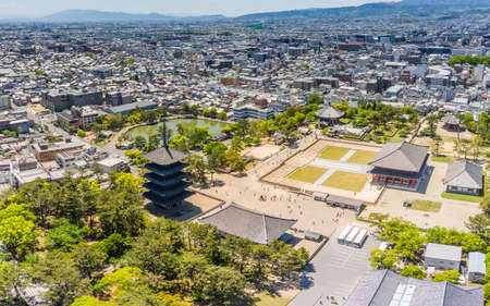 Japan, Nara - May 07, 2019: Kofukuji Temple one of the most visited sites in Nara. Visible are the Golden and Octagonal Halls and the famous Five-storied pagoda in front of Sarusawa Pond