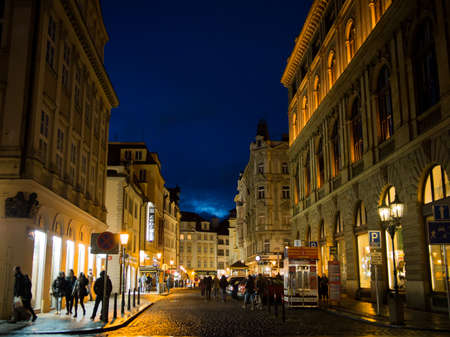 Czech Republic, Prague - March 29, 2015: Night shot and view of people walking the old town streets in Prague 에디토리얼