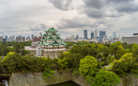 Japan, Nagoya - May 20, 2017: Aerial view of Nagoya Castle with dramatic clouds and city skyline behind 에디토리얼