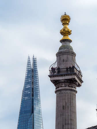 United Kingdom, London - April 05, 2015: The Monument to the Great Fire of London with the top of the Shard in the background 에디토리얼