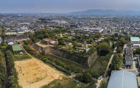 Japan, Koriyama - April 22, 2019: Aerial view of the ruins of the main keep and surrounding moat of Yamato Koriyama castle, Nara Prefecture, Japan 新聞圖片