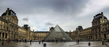 France, Paris - April 9, 2013: The Louvre Museum on the stormy rainy day in a winter season 에디토리얼