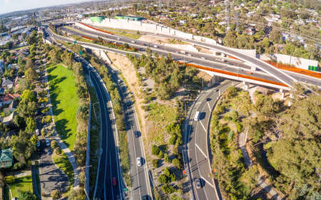 Australia, Melbourne - December 11, 2018: Cars travelling the overpass of Ringwood interchange of the Eastlink tollway in the outer Eastern suburbs of Melbourne 에디토리얼