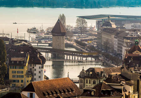 Switzerland, Lucerne - March 23, 2015: View of the old town Lucerne with the Chapel Bridge and River Reuss 에디토리얼