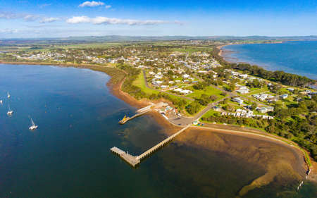 Australia, Corinella - August 29, 2019: Aerial view of the Pier and Boat Ramp of the township of Corinella in Victorias Western Port Bay, Australia 에디토리얼