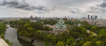Japan, Nagoya - May 20, 2017: Panoramic view of Nagoya Castle with dramatic clouds and the entire Nagoya city skyline behind