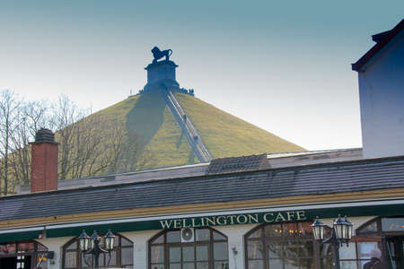 Belgium, Waterloo - April 8, 2013: The Wellington Cafe at the base of the Waterloo Lions monument, site of the famous battle of Waterloo 에디토리얼