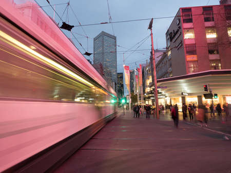 Australia, Melbourne - September 2, 2016: Long exposure of Melbourne city tram and people walking around Bourke Street in city centre