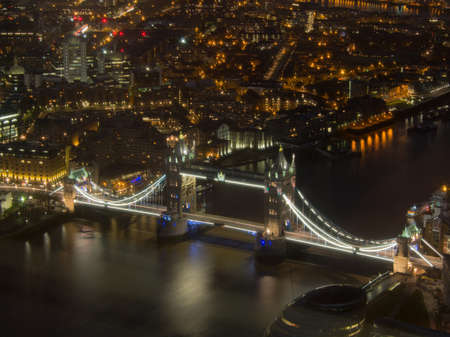 United Kingdom, London - April 05, 2015: Aerial view of iconic Tower Bridge at night on the river Thames