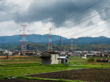 Japan, Nara - April 9, 2017: Farm land and rice fields in Nara with mountainous background, Japan