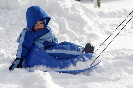 Boy on a sled photo