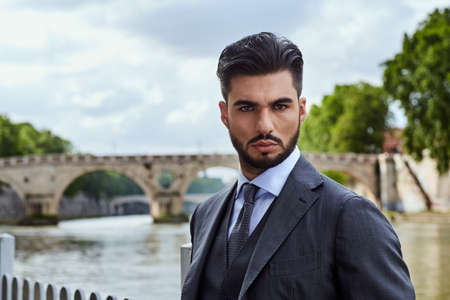 Fashion businessman looking future on river in Rome