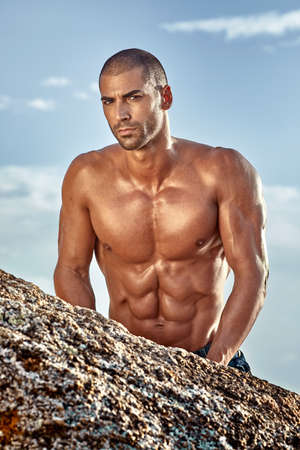 fitness half naked model looking at the camera Stock Photo