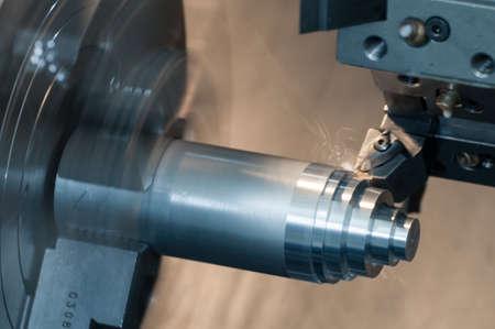 CNC Lathe machine working iron surface Stock Photo