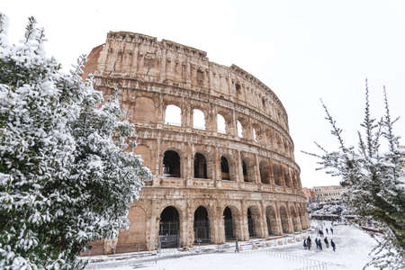 a beautiful view of Colosseum under the snow