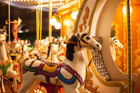 Ancient German Horse Carousel built in 1896 in Navona Square, Rome, Italy Stock Photo