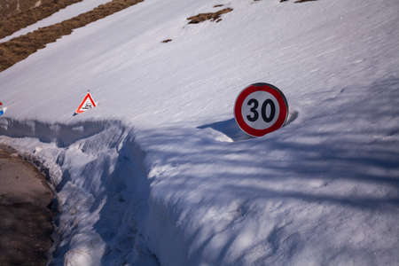 Road sign in the snow on the road to arrive in Castelluccio di Norcia, Umbria, Italy