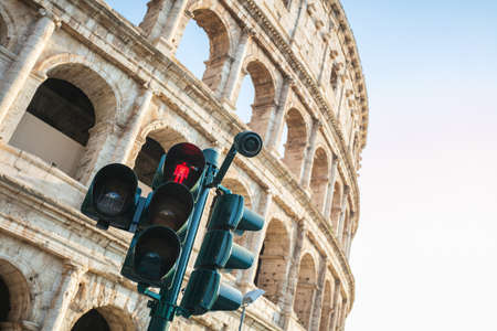 A red traffic light in front of the Colosseum, Rome