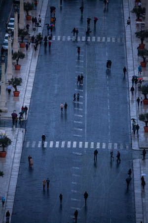A view of people in the road near Saint Peter Square from high